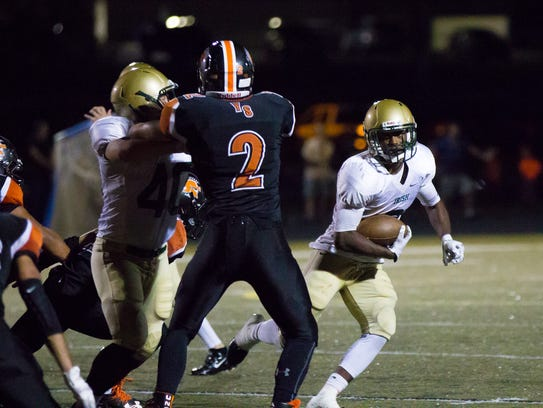 York Catholic running back Jakkar Kinard carries the