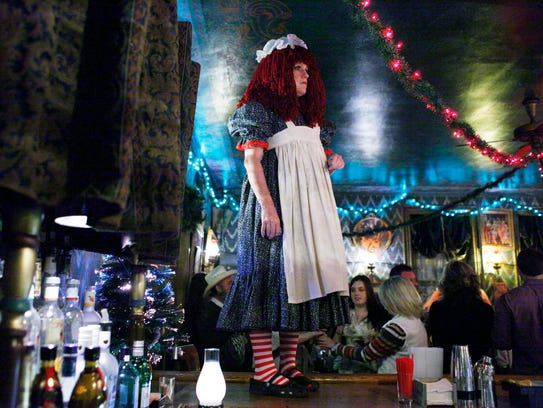 Lori Fleming, performing as the toy Ann Raggedy, stands