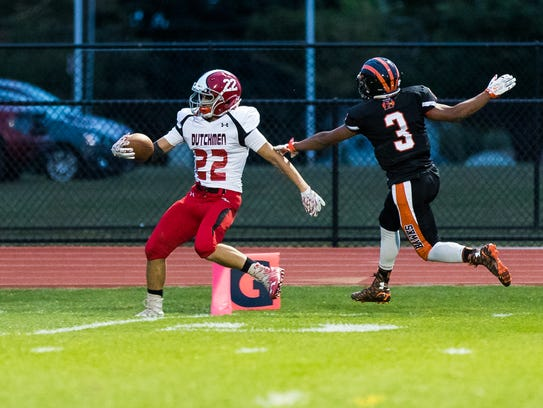 Annville-Cleona's Cameron Hoch (22) slips past Hanover's