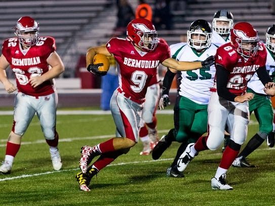 Bermudian Springs' Devon Hodgen (9) runs the ball during