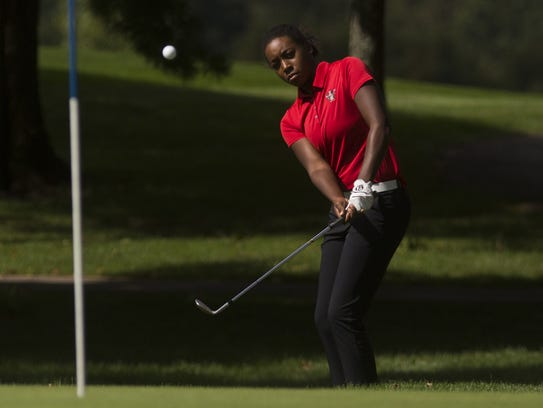 Susquehannock's Kendel Abrams hits onto the green.