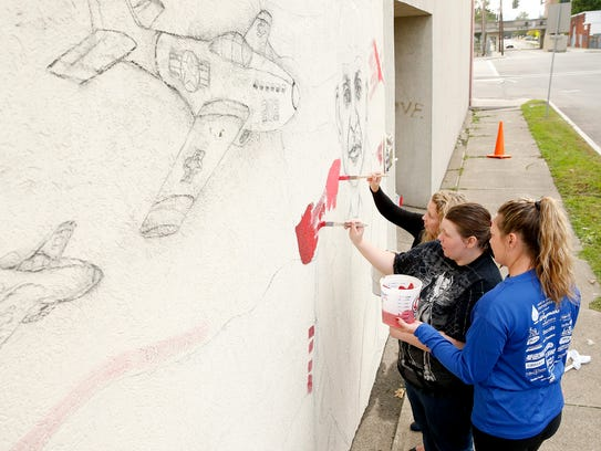 Artists and local BOCES students and staff begin painting