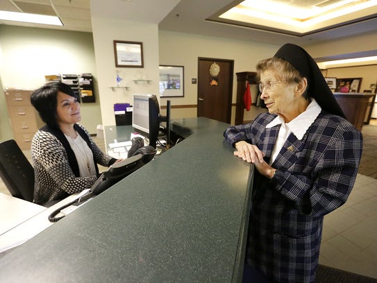 Sister Rebecca Endres (right) talks to Agnesian Cancer