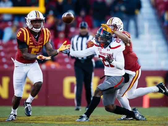Iowa State's Kamari Cotton-Moya intercepts a pass and runs it in for a touchdown in the second quarter of their football game against Texas Tech on Saturday, Nov. 19, 2016, in Ames.