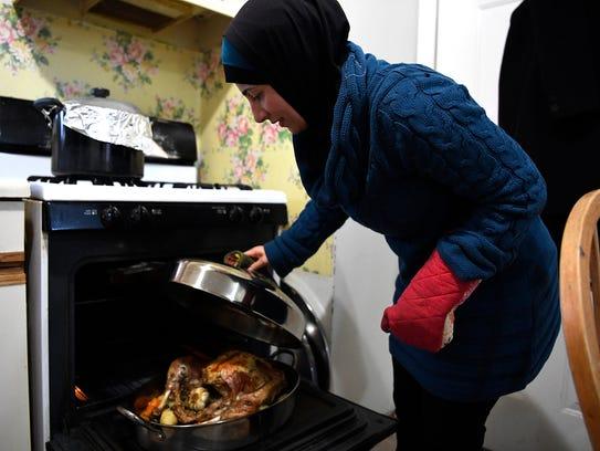 Ghussoon Zouabi, 39, checks on the turkey in her kichen