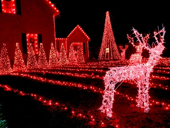 Christmas lights are all a glow at the home of Aaron