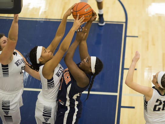 West York's Alayna Harris, center left, blocks a shot