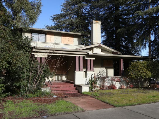 The Dobrowsky house remains boarded up to keep people