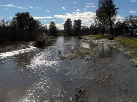 Water flows through Churn Creek on Wednesday.