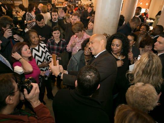 U.S. Senator Cory Booker takes a selfie with an admirer