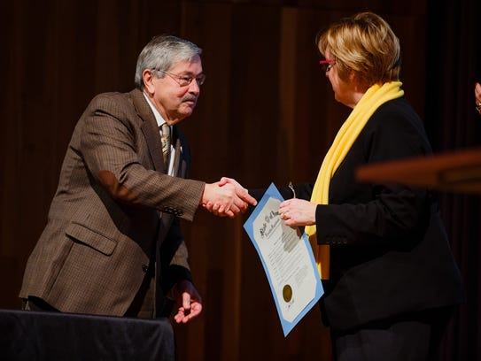 Iowa Gov. Terry Branstad signs a proclamation designating