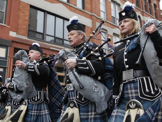 Members of Broome County Celtic Pipes & Drums march