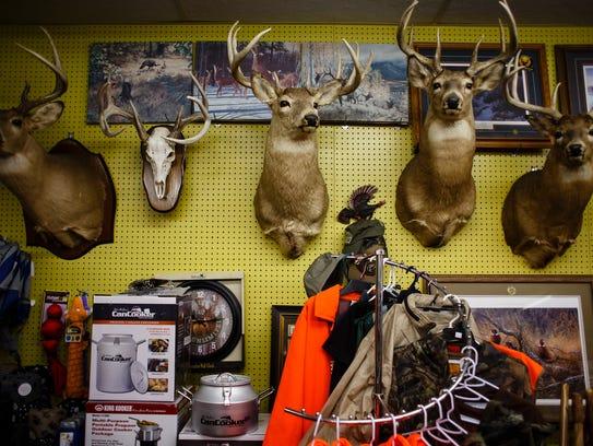 Deer mounts hang in the Elkader True Value owned by