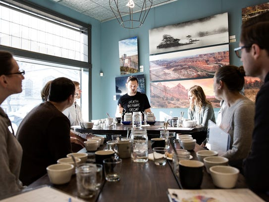 Stephen Hall leads a coffee cupping at his roastery