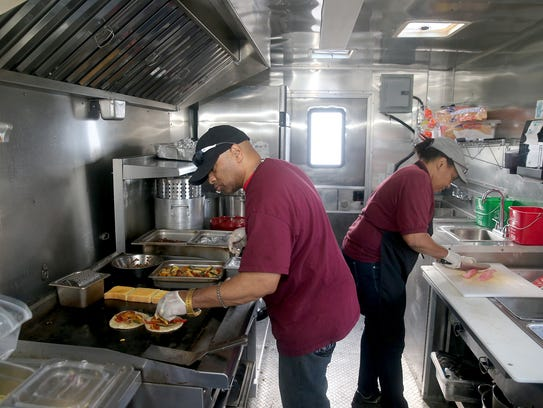 Larry Sharpe, left, and Willie Mae Sharpe prepare food
