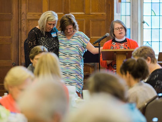 Laura Selby (left) and Daphne Johnston (center) at the 2017 Respite Ministry banquet at Montgomery's First United Methodist Church.