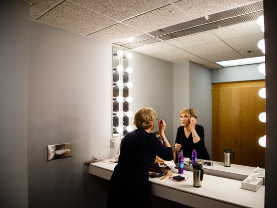 KCCI anchor Mollie Cooney puts on her makeup at the