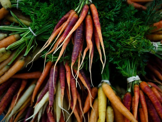 Freshly picked carrots sit ready to be sold at the