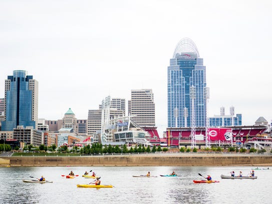 Paddlefest participants kayak on the Ohio River at