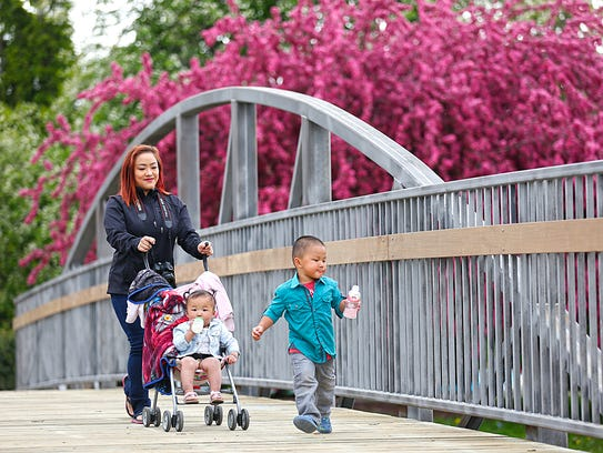 Lilly Lee, Evelyn and Aiden Xiong of Sheboygan walk