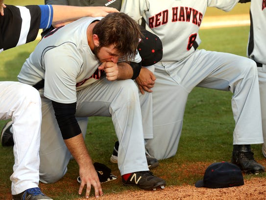 Stewarts Creek's Austin Steel (22) holds back emotions