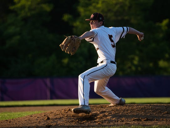East Pennsboro's Chris Horst (5) pitches during the