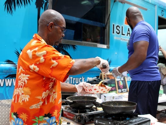 Larry Ross prepares shrimp and rice at the Islanders