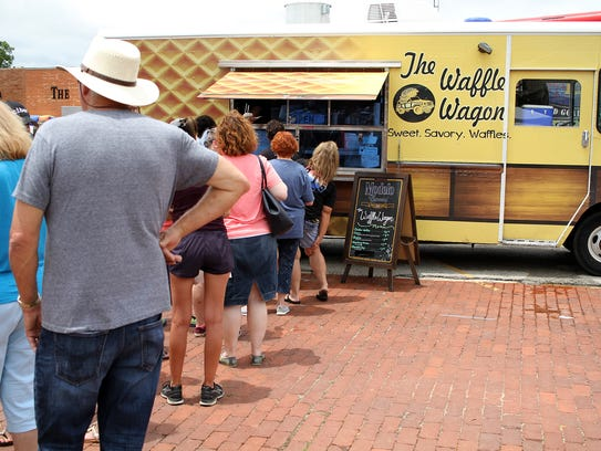 People stand in line for The Waffle Wagon at the Food