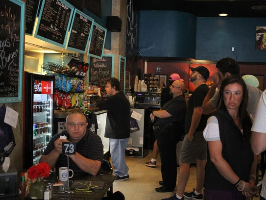 Wichitans stand in line to order coffee and breakfast