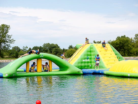 A large floating playground greets visitors at Fondy
