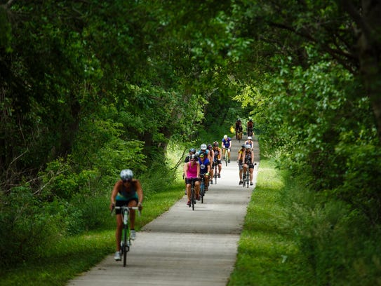 Cyclists ride on the Raccoon River Valley Trail on June 17, 2017.