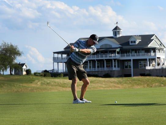 Golf Channel host Matt Ginella hits his approach shot