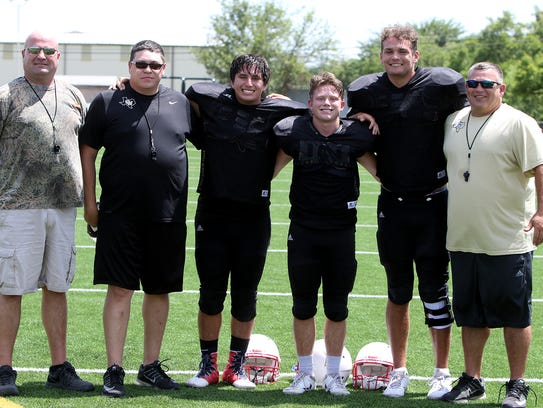 Crowell players and coaches pose for a photo at practice