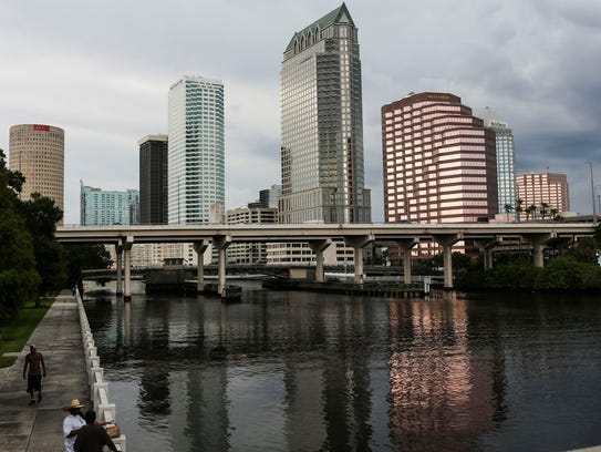 Storm clouds roll in over downtown Tampa in July.