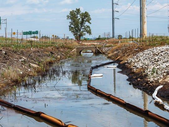 Contaminated water runs toward the Grand Calumet River