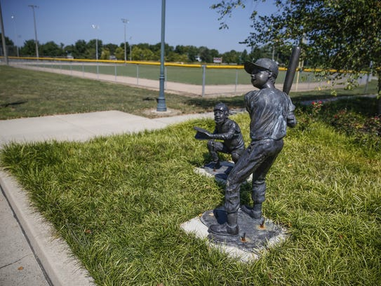 Sculptures decorate an area near the softball fields