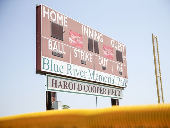A scoreboard at the park.