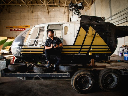In this July 13, 2017 contributed file photo, Justin Baldovino, director of cinematography for Dreamstorm productions, is shown in front of a helicopter in the Kacha Air hangar.