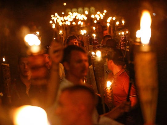 Multiple white nationalist groups march with torches