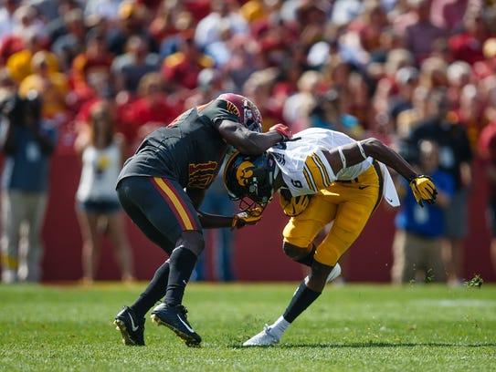Iowa's Ihmir Smith-Marsette is tackled by Iowa State