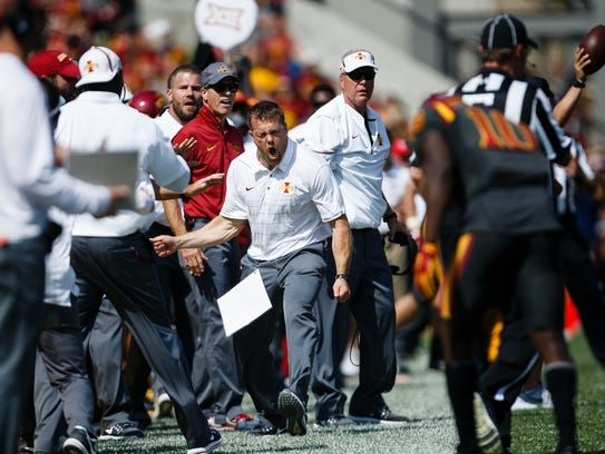 Iowa State coaches react to a call during the second