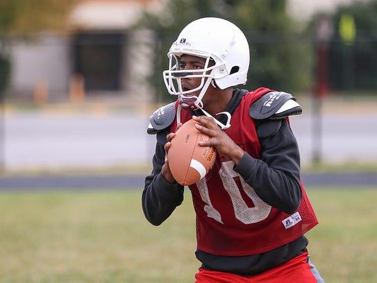 Tindley Tigers quarterback Jermaine McFadden looks