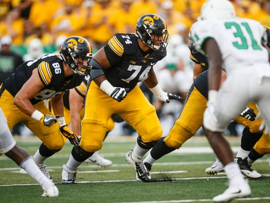 Iowa's Tristan Wirfs (74) plays right tackle against