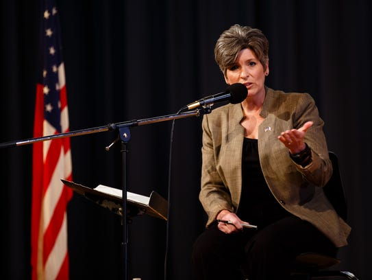 Sen. Joni Ernst speaks during a town hall at the Charles