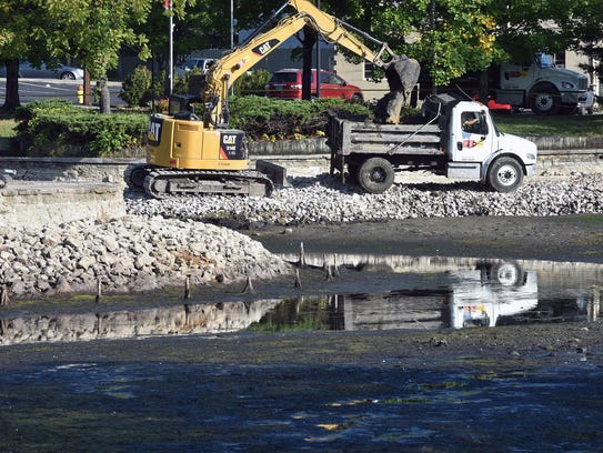 Workers descended on Fountain City Lake in a continuing
