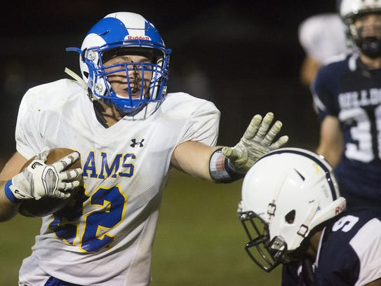 Kennard-Dale's Wyatt McCleary carries the ball. West