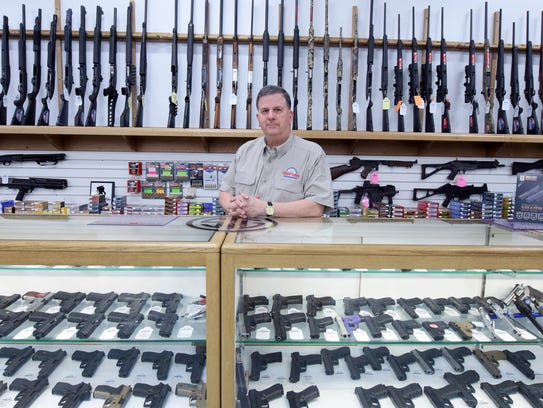 Scott Morris, owner of Freedom Armory, stands behind