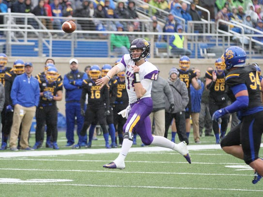 Northern Iowa's Eli Dunne (14) fires a pass for a completion