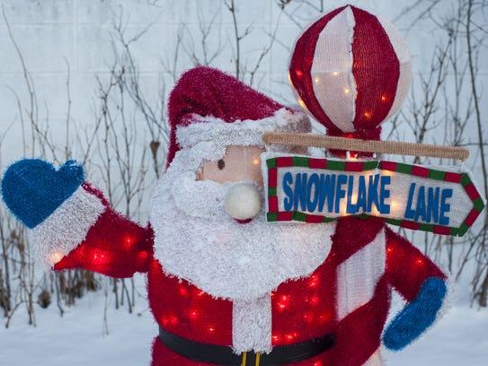 A Santa decoration marks the sidewalk by Ann Taylor's