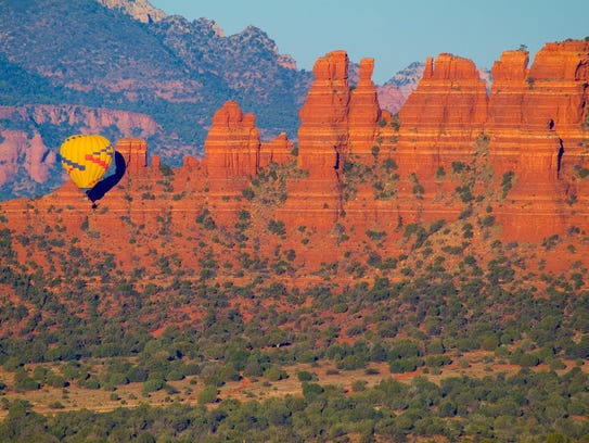 Hot air balloons lift off in the early morning to greet